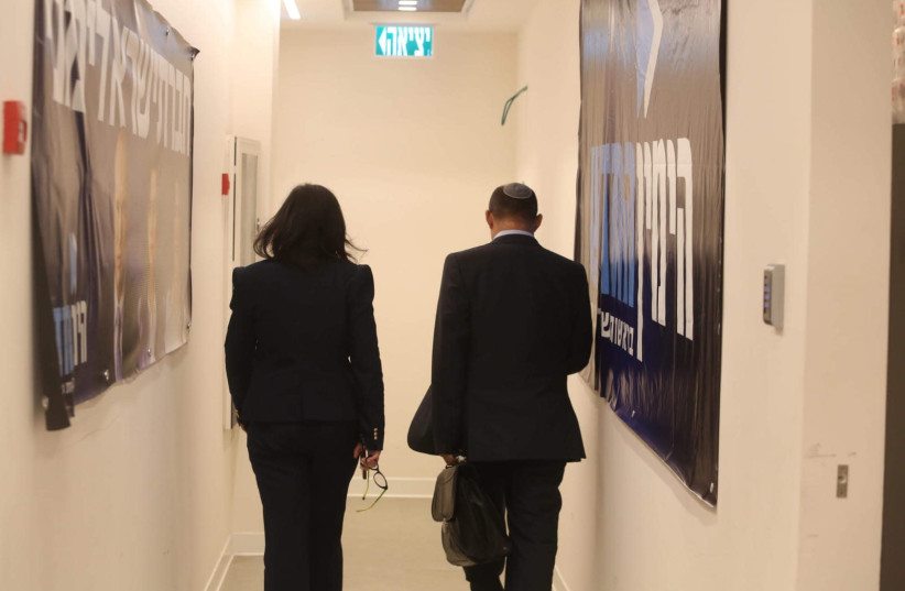 The New Right's Naftali Bennett and Ayelet Shaked walk off after exit polls show they won't enter the 21st Knesset (photo credit: MARC ISRAEL SELLEM)