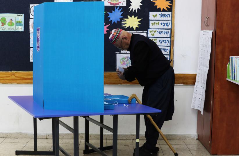Druze man votes, April 9, 2019 (photo credit: REUTERS/AMMAR AWAD)