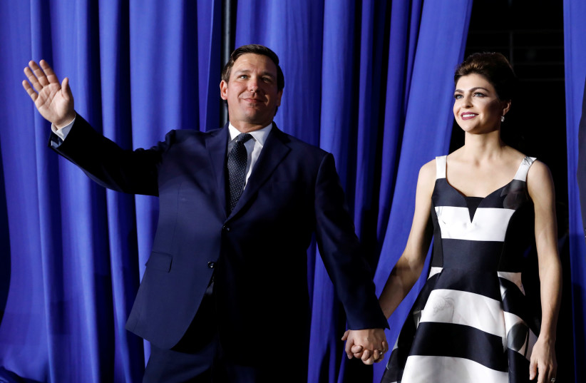Florida Governor Ron DeSantis arrives with his wife Casey to hear U.S. President Donald Trump to speak about the crisis in Venezuela at Florida International University in Miami, Florida, U.S., February 18, 2019 (photo credit: KEVIN LAMARQUE/REUTERS)