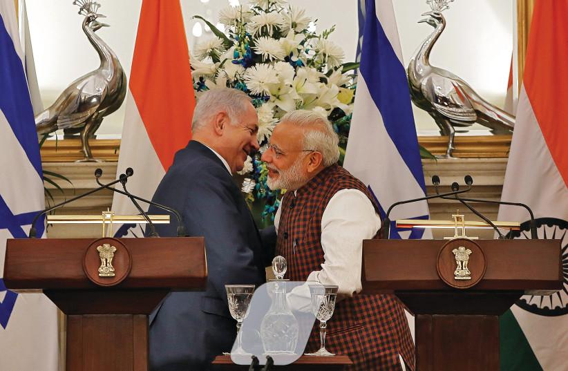 PRIME MINISTER Benjamin Netanyahu and his Indian counterpart Narendra Modi (photo credit: ADNAN ABIDI/ REUTERS)