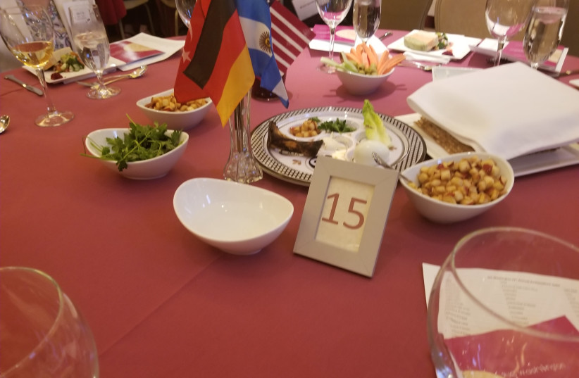 The Seder plate at the annual AJC mock Seder for diplomats in Washington, on April 11, 2019 (photo credit: OMRI NAHMIAS)