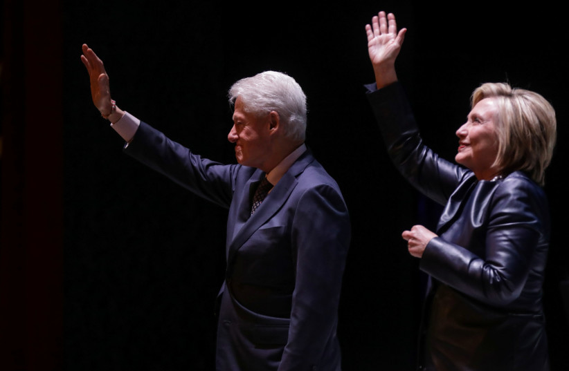 Former Secretary of State Hillary Clinton and former President Bill Clinton, New York, 2019. (photo credit: STEPHEN YANG / REUTERS)