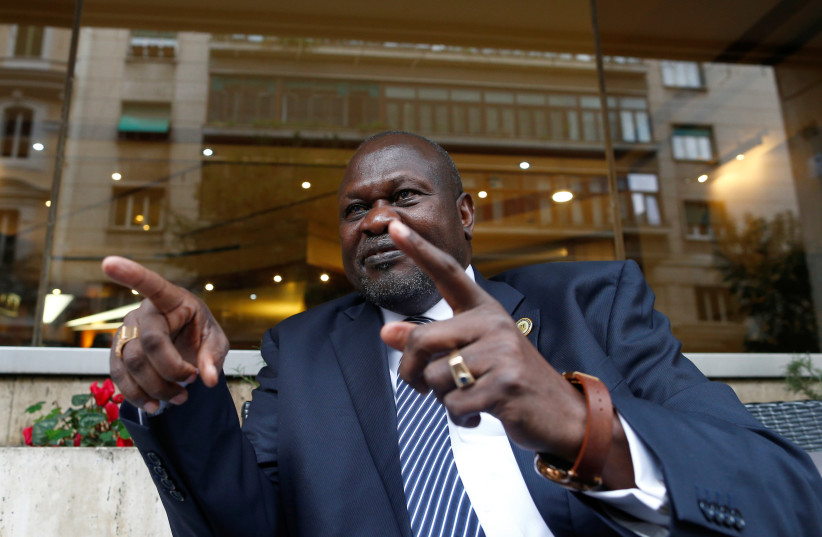 South Sudan's ex-vice president and former rebel leader Riek Machar gestures during an interview with Reuters in Rome, Italy, April 12, 2019 (photo credit: YARA NARDI / REUTERS)