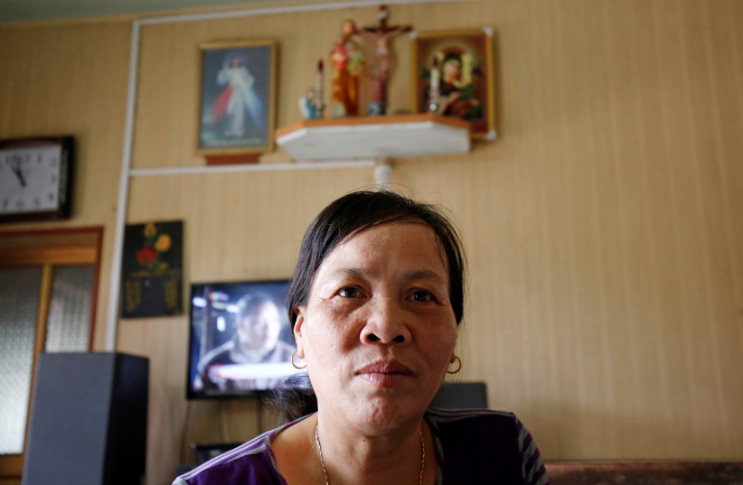 Nguyen Thi Vy, stepmother of Doan Thi Huong, the Vietnamese suspect in Kim Jong Nam's murder, receives a phone call in her house in Nam Dinh province, Vietnam April 1, 2019 (photo credit: KHAM / REUTERS)