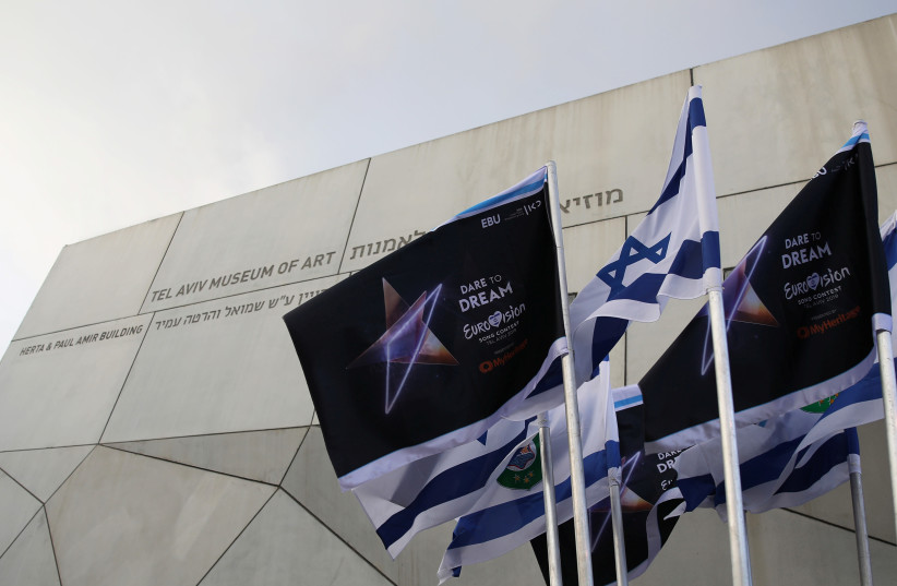 Israeli flags and flags bearing the logo of the 2019 Eurovision song contest flutter outside the Tel Aviv Museum of Art, during the Eurovision Semi-Final allocation draw, in Tel Aviv. (photo credit: CORINNA KERN/REUTERS)