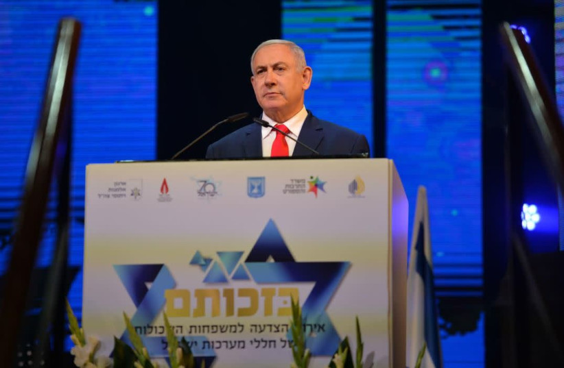 Prime Minister Benjamin Netanyahu at an event honoring families who lost relatives during the wars of Israel   (photo credit: KOBI GIDEON/GPO)