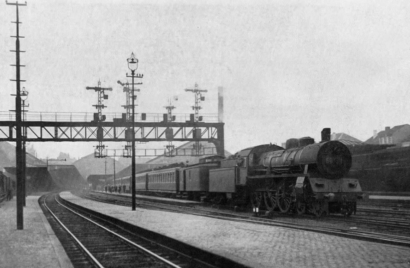 A train to Antwerp leaving the Brussels-North station in the 1920s (photo credit: Wikimedia Commons)