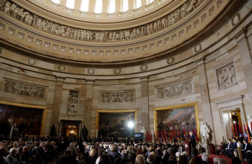 """U.S. President Donald Trump delivers the keynote address at the U.S. Holocaust Memorial Museum's """"Days of Remembrance"""" ceremony in the The Capitol Rotunda on Capitol Hill, in Washington, DC (photo credit: REUTERS/YURI GRIPAS)"""