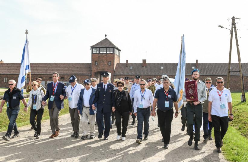 The FIDF delegation marches into Auschwitz-Birkenau in 2018. (photo credit: SHAHAR AZRAN)