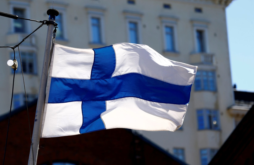 Finland's flag flutters in Helsinki, Finland, May 3, 2017 (photo credit: INTS KALNINS / REUTERS)