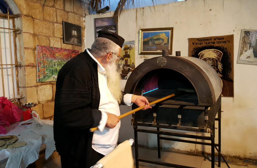 Baking matzah for the Passover holiday at the Meir Moshe Levy Synagogue in the Nachlaot neighborhood of Jerusalem, April 11, 2019 (photo credit: BEN BRESKY)