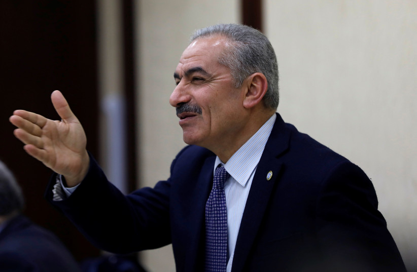 Mohammad Shtayyeh gestures during a Palestinian leadership meeting in Ramallah, in the Israeli-occupied West Bank February 20, 2019.  (photo credit: MOHAMAD TOROKMAN/REUTERS)