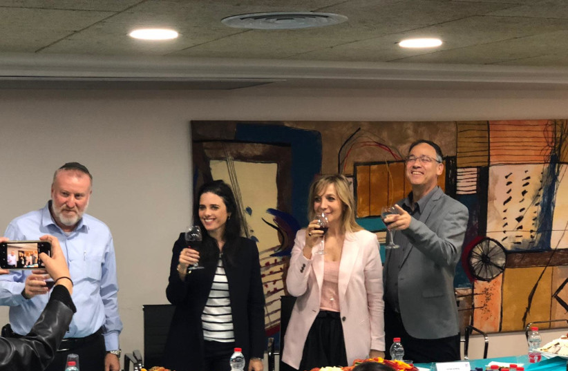 Ayelet Shaked raises a toast to Justice Ministry workers before Passover on April 17th, 2019 (photo credit: Courtesy)