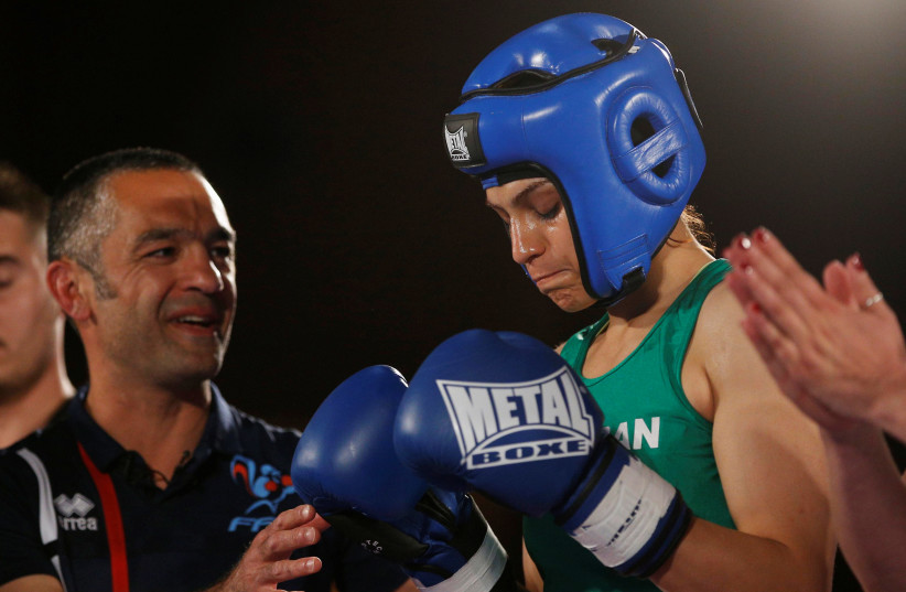 Iranian boxer Sadaf Khadem and coach Mahyar Monshipour react before the fight against French boxer Anne Chauvin during an official boxing bout in Royan, France, April 13, 2019 (photo credit: STEPHANE MAHE / REUTERS)