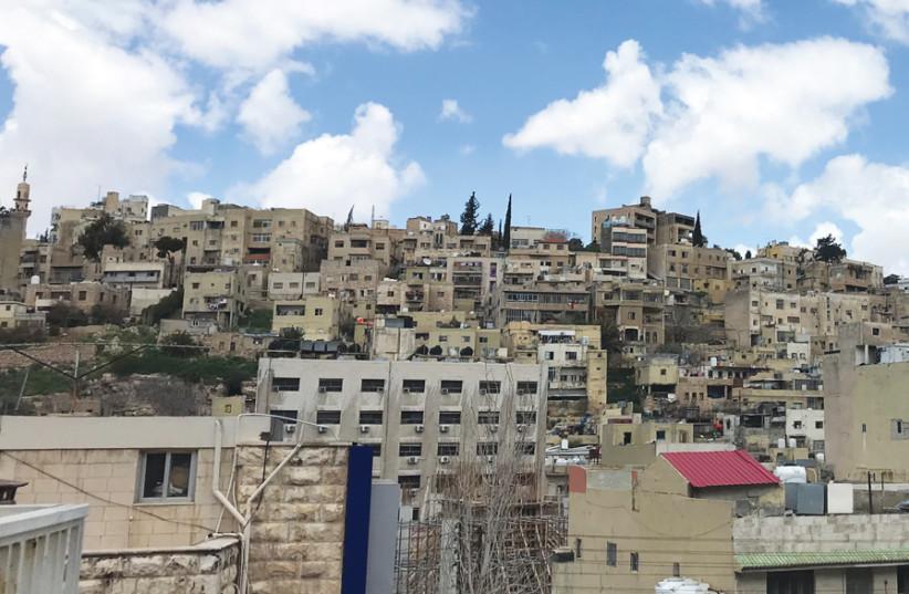 AMMAN SKYLINE: 'Most of Jordan's identity comes from the kingdom established in 1921.' (photo credit: SETH J. FRANTZMAN)