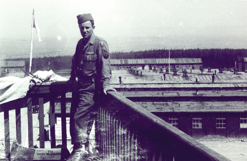 A SOMBER PFC Victor Geller overlooking the newly liberated Buchenwald, May, 1945. (photo credit: VICTOR GELLER PRIVATE COLLECTION)