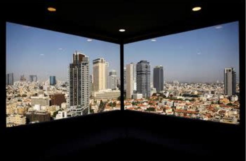 A general view of Tel Aviv's skyline is seen through a hotel window in Tel Aviv, Israel May 15, 2017. (photo credit: AMIR COHEN - REUTERS)