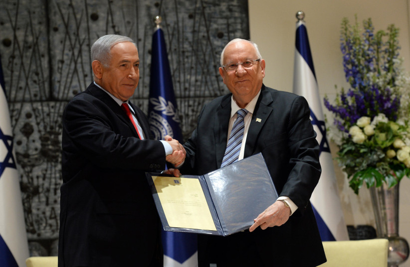 President Rivlin entrusting Prime Minister Netanyahu with forming the government (photo credit: HAIM ZACH/GPO)