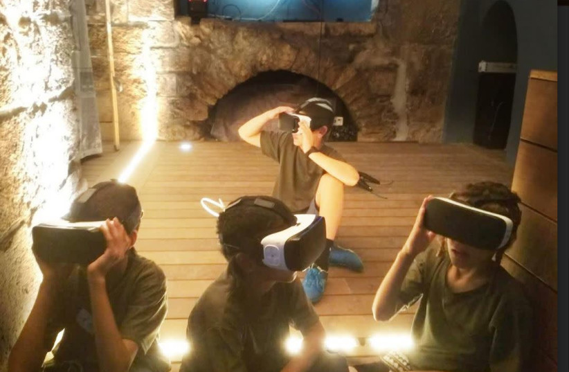 Children using virtual reality technology to learn about Jewish culture  (photo credit: Courtesy)