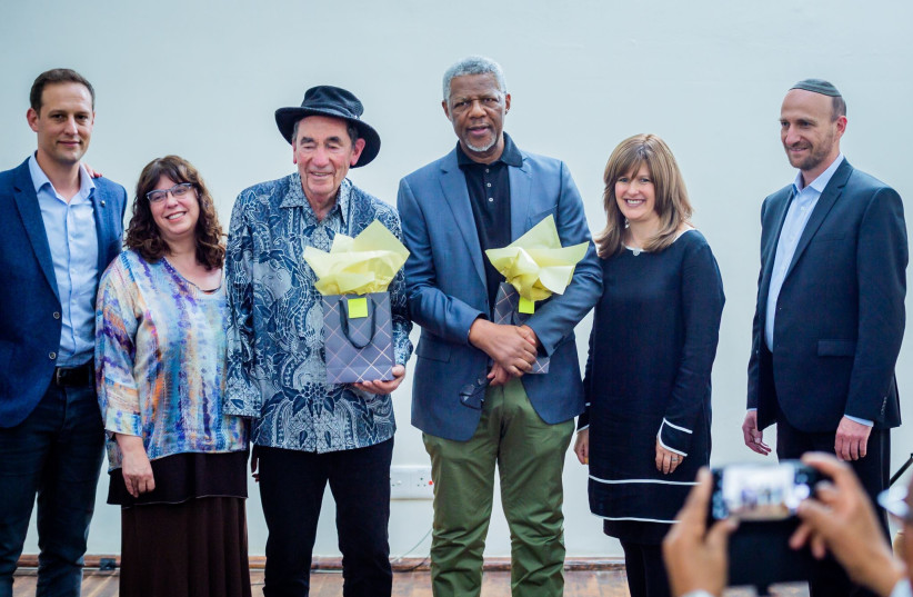 Members of South Africa's Jewish Communal leadership pose with anti-apartheid stalwarts Justice Albie Sachs and Mavuso Msimang. (photo credit: PHOTOGRAPHY BY ALON)