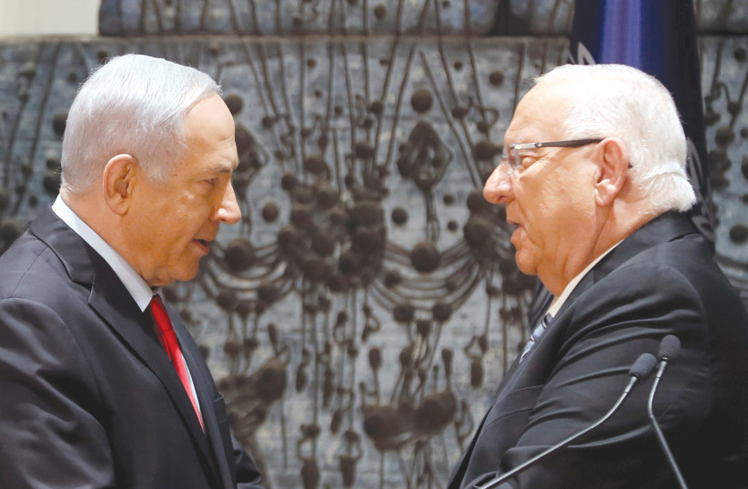 PRESIDENT REUVEN Rivlin and Prime Minister Benjamin Netanyahu face off at the President's residence in Jerusalem on Wednesday night (photo credit: RONEN ZVULUN/REUTERS)