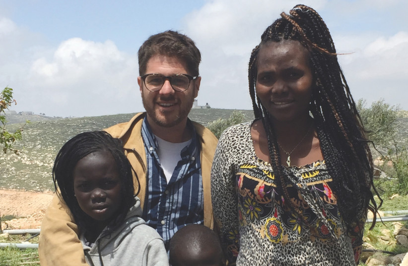 A.Y. KATSOF with Piath Aguar and her two children, Ayen and Bior, celebrating their new life in Israel at Katsof's home in Eish Kodesh (photo credit: Courtesy)