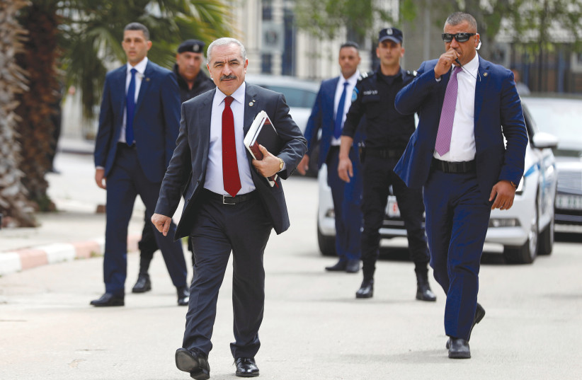 HEADED TOWARD conflict? Palestinian Prime Minister Mohammad Shtayyeh arrives for a cabinet meeting of the new Palestinian government, in Ramallah, earlier this week (photo credit: REUTERS/MOHAMAD TOROKMAN)