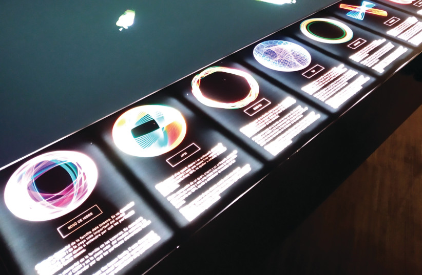 """""""Quantum Universe,"""" is a virtual particle generator that shows the shape of particles based on scientific evidence and is curated by Alex Posada in the Exhibition 'Quantum' at the Center of Contemporary Culture of Barcelona (CCCB) (photo credit: CASSANDRA GOMES HOCHBERG)"""