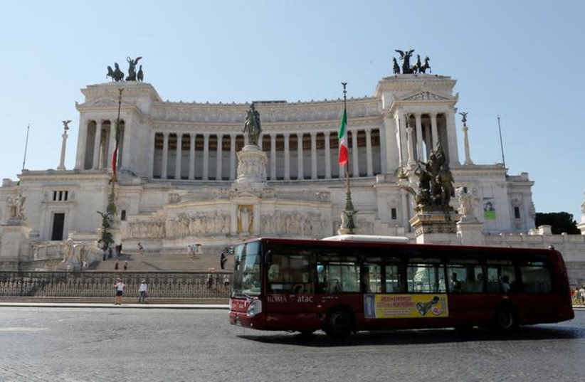 A public bus is seen in downtown Rome, Italy (photo credit: REUTERS/TONY GENTILE)