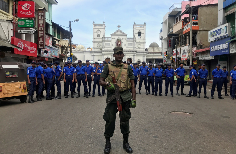 Sri Lankan military officials stand guard in front of the St. Anthony's Shrine, Kochchikade church after an explosion in Colombo, Sri Lanka  (photo credit: DINUKA LIYANAWATTE/REUTERS)