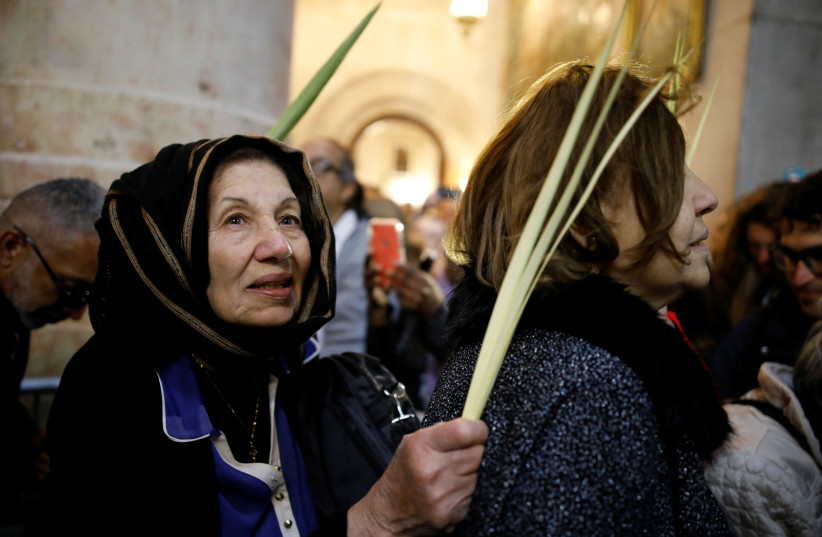 Christian worshippers attend Easter Sunday Mass in Jerusalem's Holy Sepulcher Church April 21, 2019 (photo credit: AMIR COHEN/REUTERS)