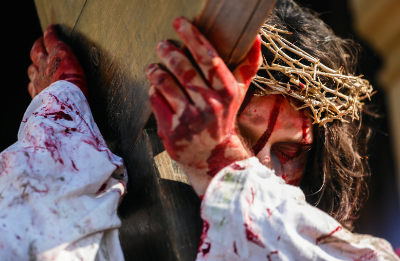 An actor portraying Jesus Christ takes part in Passion Play as part of Good Friday celebrations at the Sanctuary of Kalwaria Zebrzydowska near Krakow, Poland April 19, 2019. (photo credit: AGENCJA GAZETA/ADRIANNA BOCHENEK VIA REUTERS)