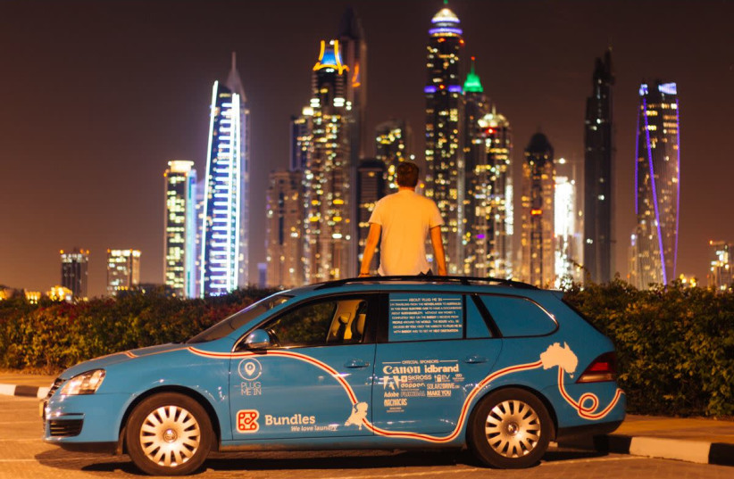 Dutch adventurer Wiebe Wakker on his electric car journey from the Netherlands to Australia, in Dubai, UAE December 2016 in this picture obtained from social media.  (photo credit: REUTERS)