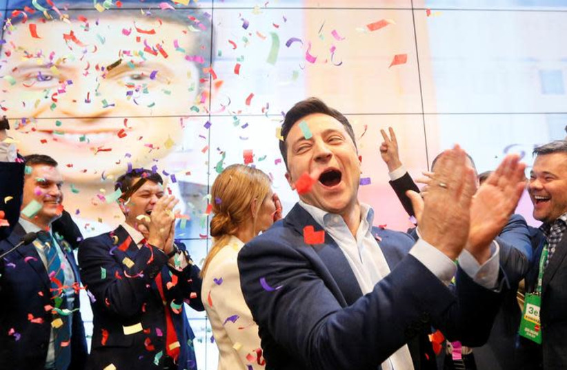 Ukrainian presidential candidate Volodymyr Zelenskiy reacts following the announcement of the first exit poll in a presidential election at his campaign headquarters in Kiev, Ukraine April 21, 2019 (photo credit: REUTERS/VALENTYN OGIRENKO)