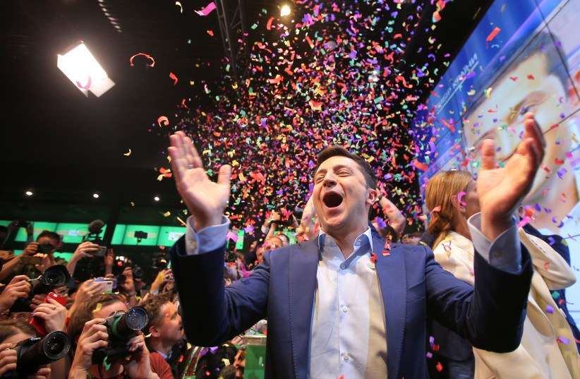 Ukrainian presidential candidate Volodymyr Zelenskiy reacts following the announcement of the first exit poll in a presidential election at his campaign headquarters in Kiev, Ukraine April 21, 2019 (photo credit: REUTERS)