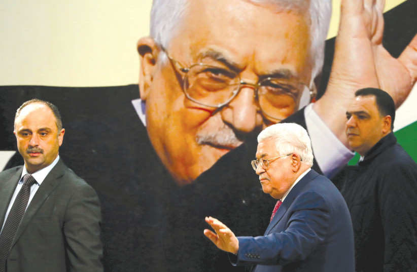 Palestinian Authority President Mahmoud Abbas gestures during a ceremony marking the 54th anniversary of Fatah's founding, in Ramallah on December 31 (photo credit: REUTERS)