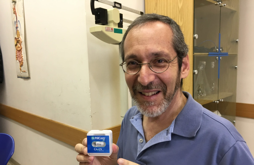 Writer Brian Blum with the PillCam unit, a Start-Up nation success story (photo credit: Courtesy)