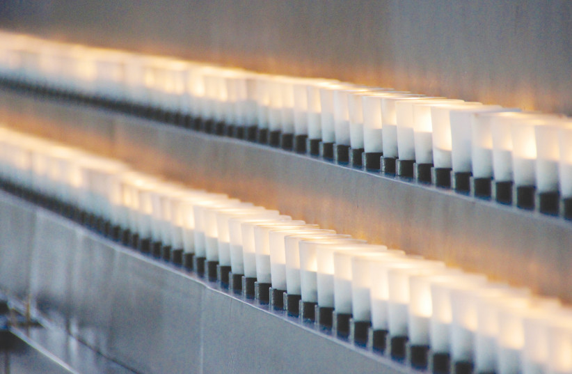 Holocaust memorial candles (photo credit: TED EYTAN/FLICKR)