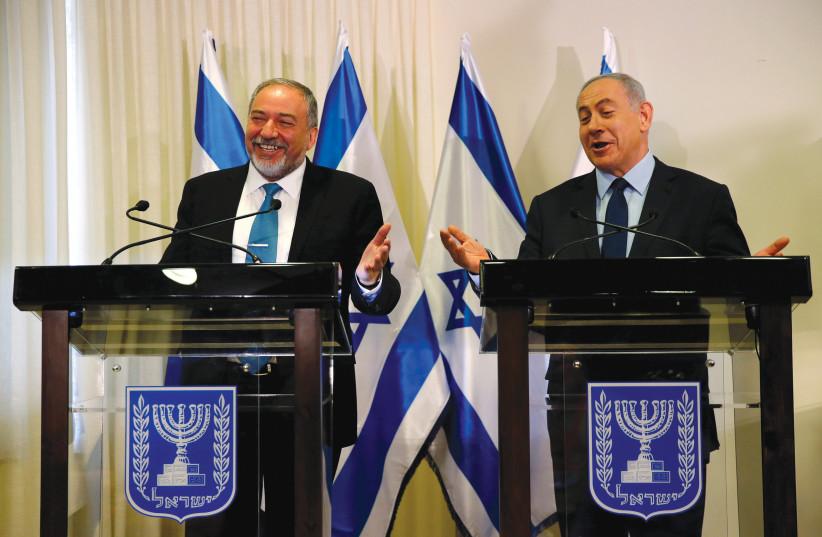 WILL THEY laugh again in a few weeks? Prime Minister Benjamin Netanyahu and Yisrael Beytenu chairman Avigdor Liberman (photo credit: REUTERS)