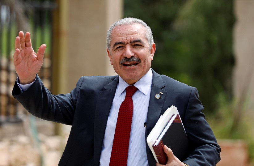 PA Prime Minister Mohammad Shtayyeh gestures as he arrives for a cabinet meeting of the new Palestinian government, in Ramallah, April 15, 2019 (photo credit: MOHAMAD TOROKMAN/REUTERS)