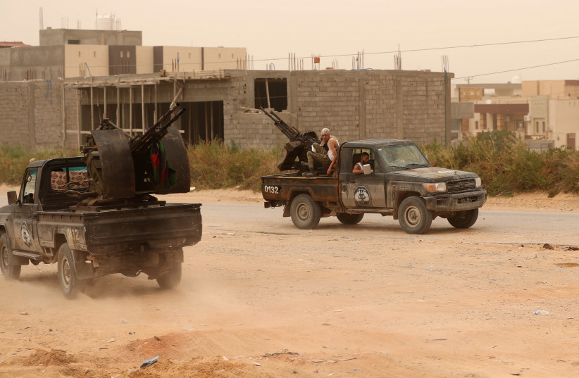 LIBYAN GOVERNMENT forces take position during fighting in Ain Zara, in Tripoli, earlier this week (photo credit: REUTERS/AHMED JADALLAH)