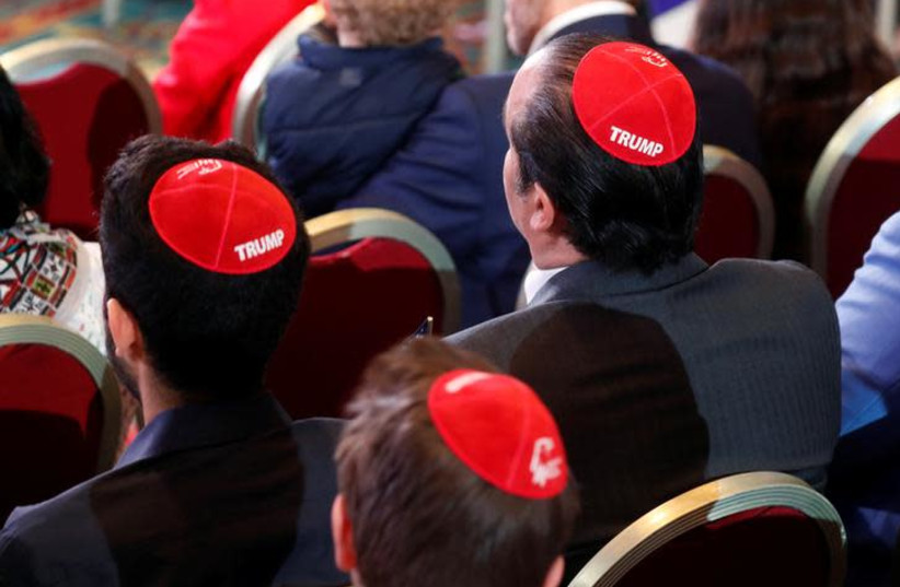 Men wear Trump yarmulkes while waiting for U.S. President Donald Trump to address the Republican Jewish Coalition 2019 Annual Leadership Meeting in Las Vegas (photo credit: REUTERS/KEVIN LAMARQUE)