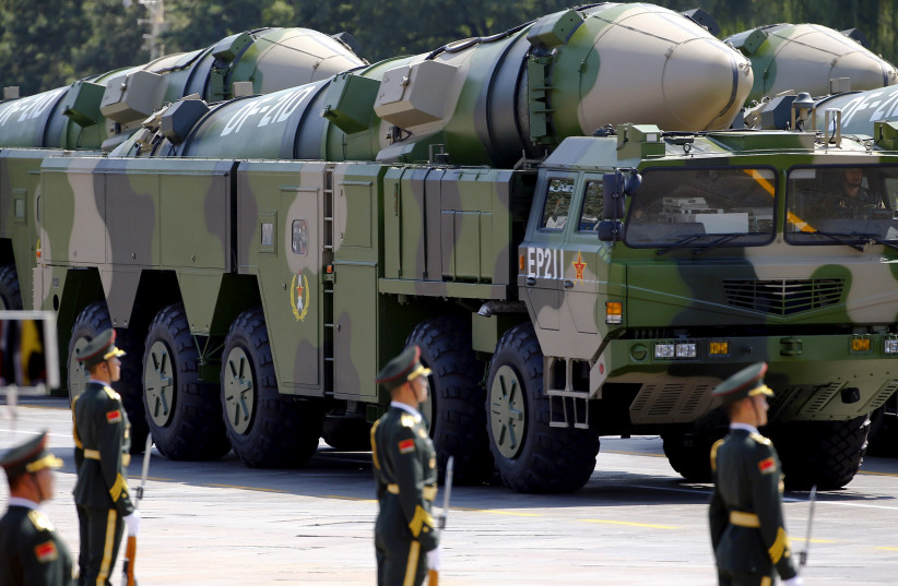 FILE PHOTO - Military vehicles carrying DF-21D ballistic missiles roll to Tiananmen Square during a military parade to mark the 70th anniversary of the end of World War Two, in Beijing, China, September 3, 2015 (photo credit: DAMIR SAGOLJ/ REUTERS)