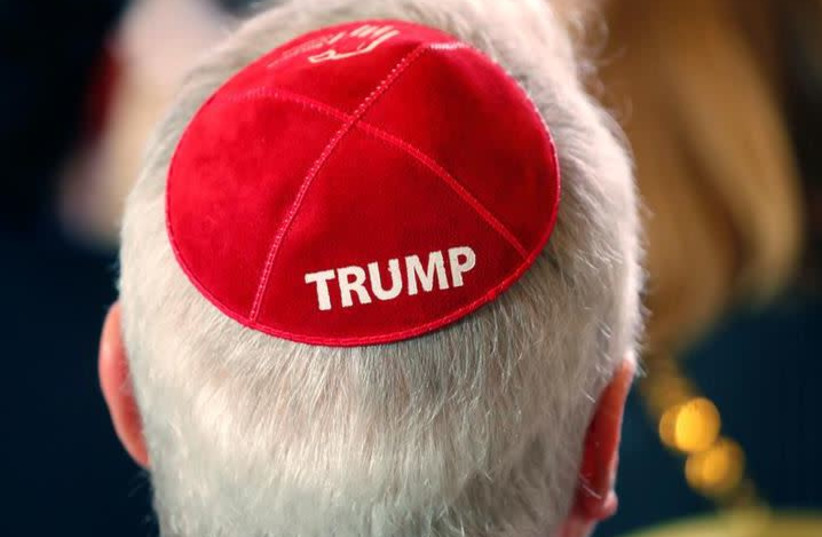 A man wears a Trump yarmulke while waiting for U.S. President Donald Trump to address the Republican Jewish Coalition 2019 Annual Leadership Meeting in Las Vegas, Nevada, U.S., April 6, 2019. (photo credit: KEVIN LAMARQUE/REUTERS)
