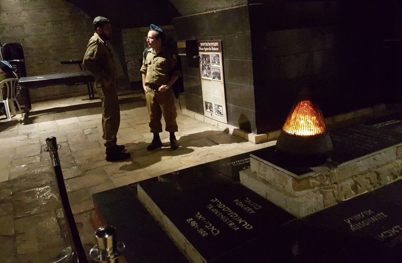 IDF soldiers at the Chamber of the Holocaust, Mount Zion, Jerusalem for a Yom HaShoah ceremony, April 11, 2018 (photo credit: BEN BRESKY)