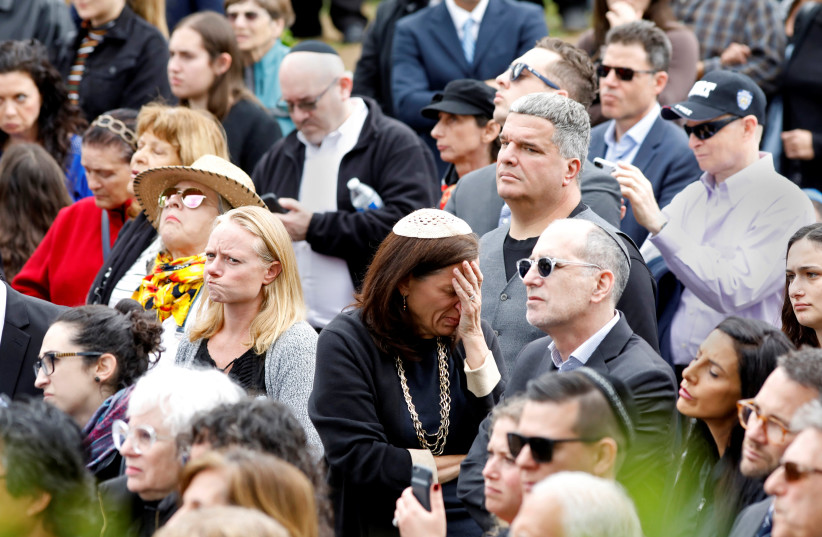 A crowd watches on screen the funeral for Lori Gilbert-Kaye, the sole fatality of the Saturday synagogue shooting at the Congregation Chabad synagogue in Poway, north of San Diego, California, U.S. April 29, 2019 (photo credit: JOHN GASTALDO/REUTERS)