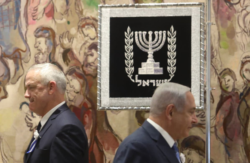 Benny Gantz and Benjamin Netanyahu at swearing in of 21st Knesset (photo credit: MARC ISRAEL SELLEM)
