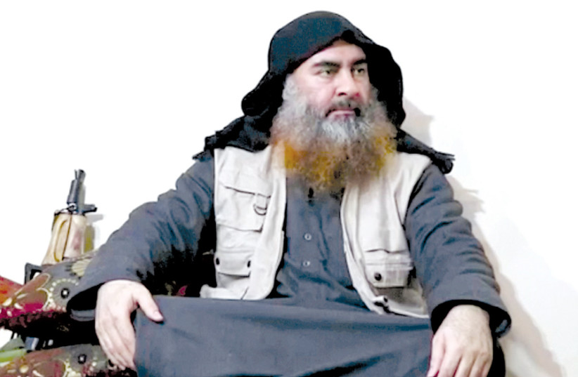 A MAN purported to be Islamic State leader Abu Bakr al-Baghdadi speaks in this screen grab taken from video released on April 29. (photo credit: REUTERS)