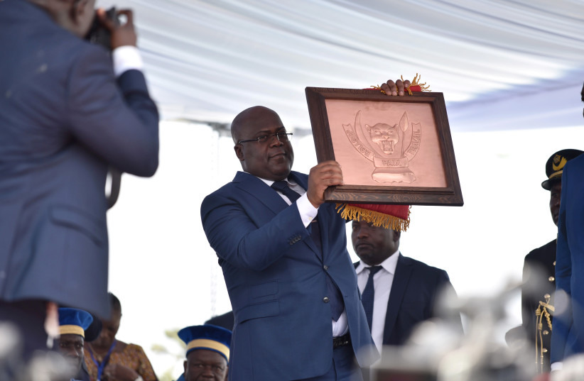 Felix Tshisekedi holds the country's coat of arms during the inauguration ceremony whereby Tshisekedi was sworn into office as the new president of the Democratic Republic of Congo at the Palais de la Nation in Kinshasa, Democratic Republic of Congo, January 24, 2019 (photo credit: OLIVIA ACLAND/REUTERS)