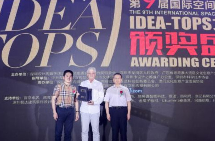 Architect Etan Kimmel accepting two awards at the 9th annual International Space Design Award Idea-Tops in Shenzhen, China, April 25, 2019 (photo credit: Courtesy)